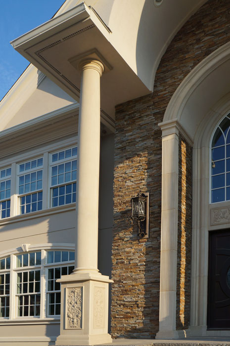 "Custom fluted pilasters with 12"" cast molding, tapered columns with Doric base and cap, and custom carved plinth blocks."