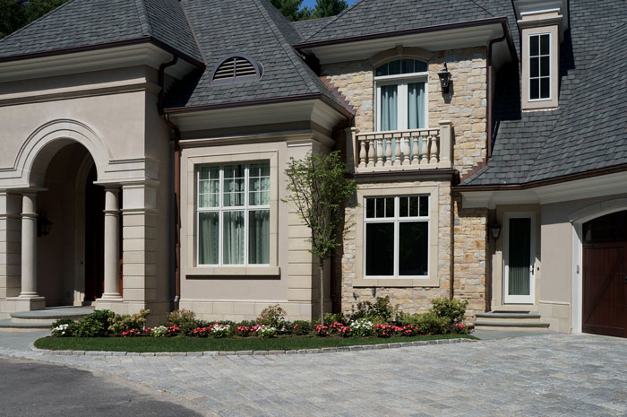 Natural Stone Veneer with cast stone trim and dimensional panels