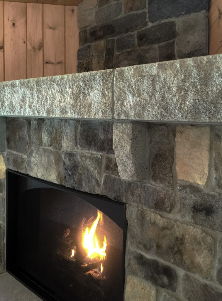 The Acadia Fireplace Mantel With New England Veneer Stone In Ashlar Blend